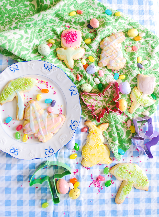 Pretty spring sugar cookies with pastel icing in bunny, tulip, butterfly, and umbrella shapes