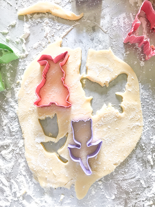 Cutting out pretty spring sugar cookies