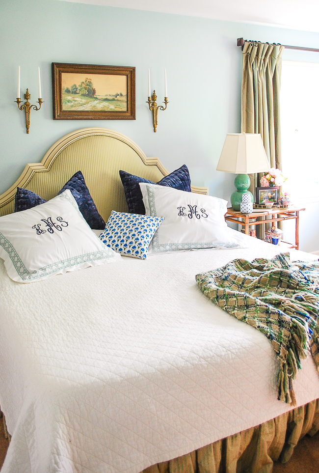 master bedroom in blues and greens decorated with antiques, bamboo, monograms, and stripes