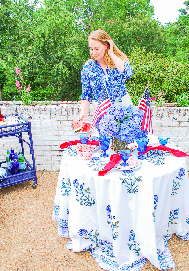 Katherine places watermelon on her July 4th patriotic table