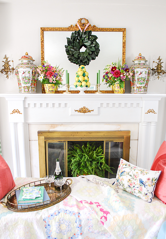 Grandmillennial mantel decor with magnolia wreath, lemon topiary, and fresh florals