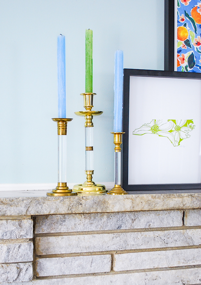 One elevated essential of mantel decor is lighting. Here I've grouped 3 vintage acrylic and brass candlesticks.