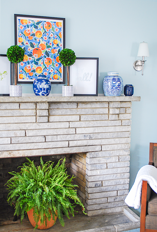 Knick knacks like blue and white ginger jars are an important decorative element on this preppy traditional mantel