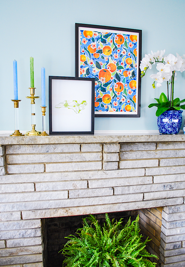 Preppy traditional mantel featuring orange print by Charlotte Nicholson from FY!