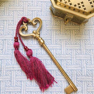 Vintage brass key with burgundy tassel