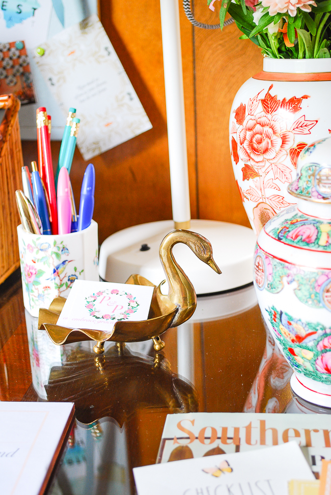 Vintage brass swan card holder for desk organization - an important tip for productivity when working from home