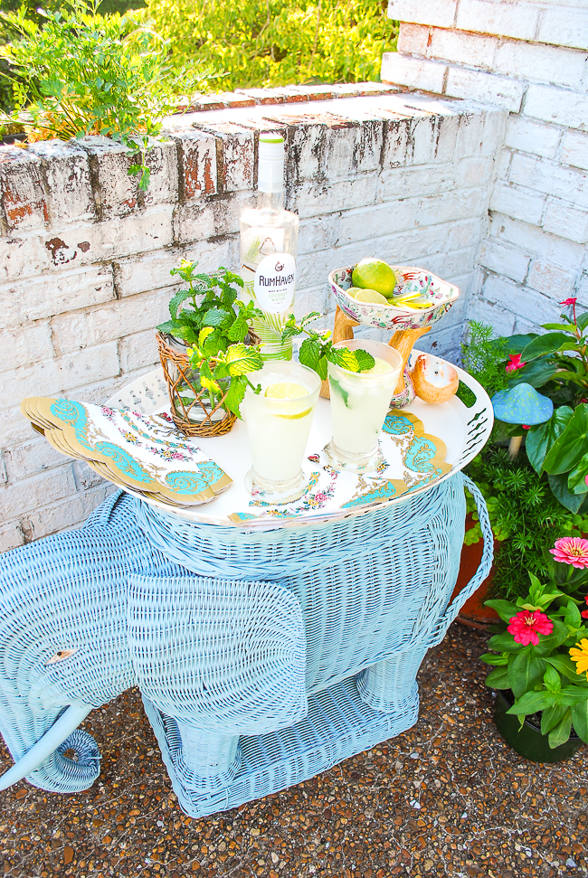 Vintage wicker elephant stand used as bar for coconut mojitos