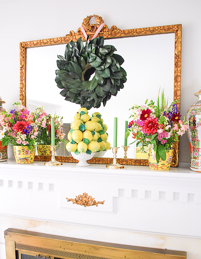 Natural elements with a magnolia wreath and fresh florals play a major role on this mantel
