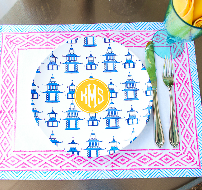 Colorful summer place setting with Indian block print placemat, pagoda monogrammed plate, and aqua goblet