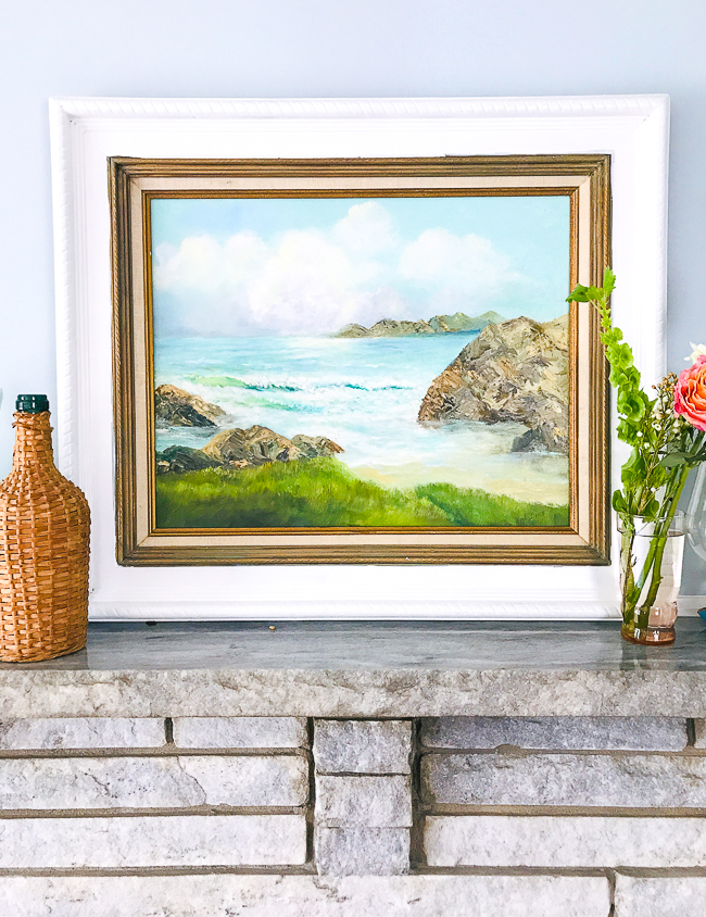 Seascape painting in white frame