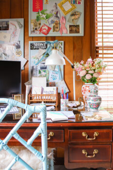 Home desk with fresh flowers, antique ceramics, inspirational boards for a successful work space to have a productive 9 to 5 at home from an introverted business owner and blogger