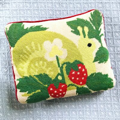 Snail and strawberry needlepoint pillow