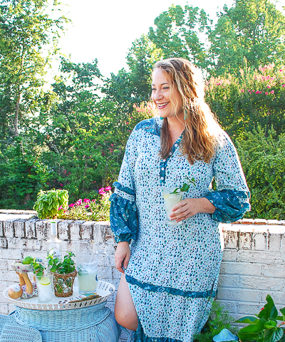 portrait of Katherine outside in caftan with mojito
