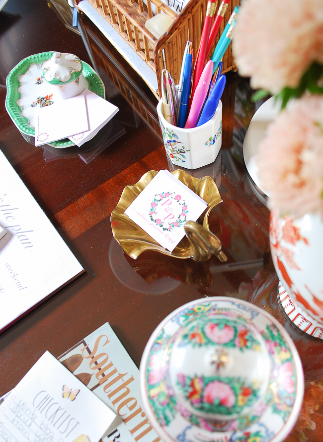 Vintage trays, pen cup, and caddies for organizing desk. Creating a pretty home office helps your stay producing when working from home.