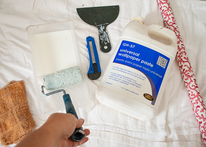 Supplies and tools for backing a china cabinet with wallpaper