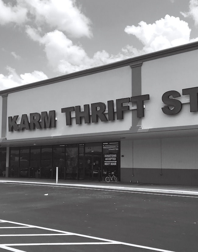 Front KARM Thrift Store sign on building in black and white - One of my favorite thrift stores in East Tennessee