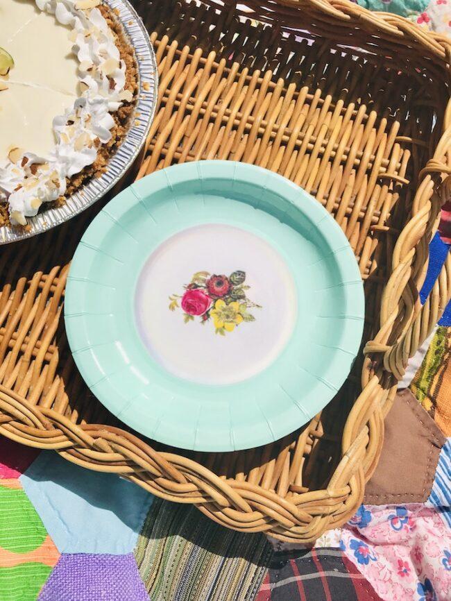 aqua paper plate with floral center design