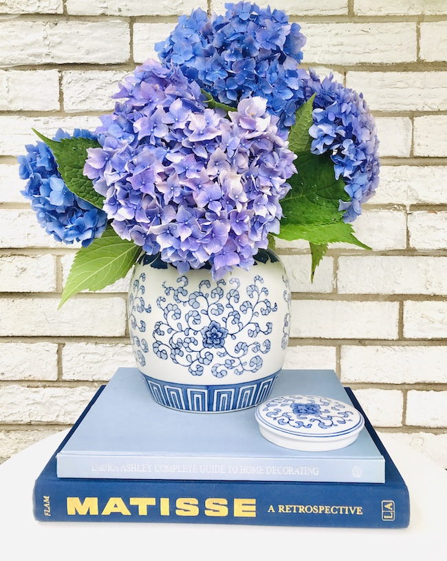 Blue and white floral ginger jar with blue hydrangeas