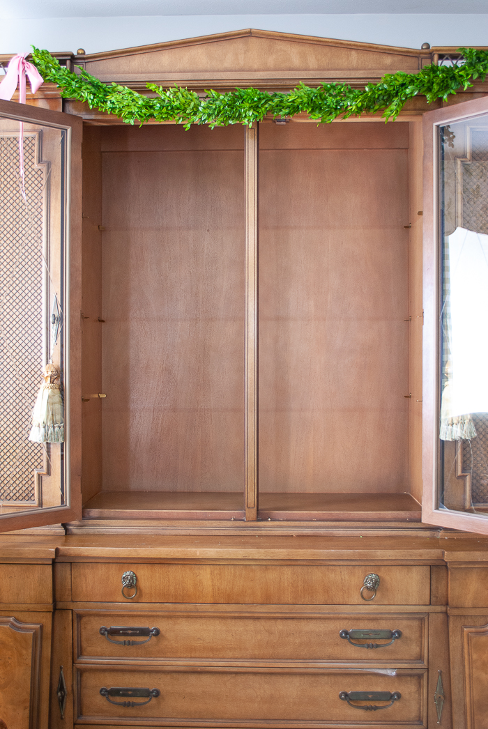 Empty china cabinet ready for wallpaper install
