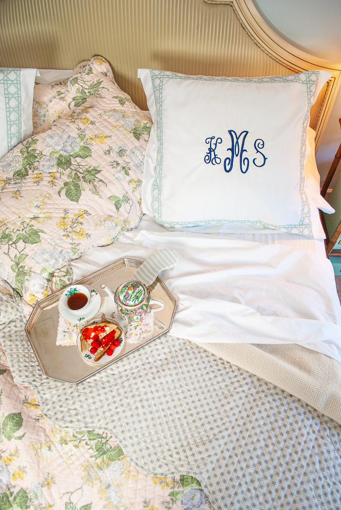 Turned down bed with Katherine's monogram on pillow and silver breakfast tray