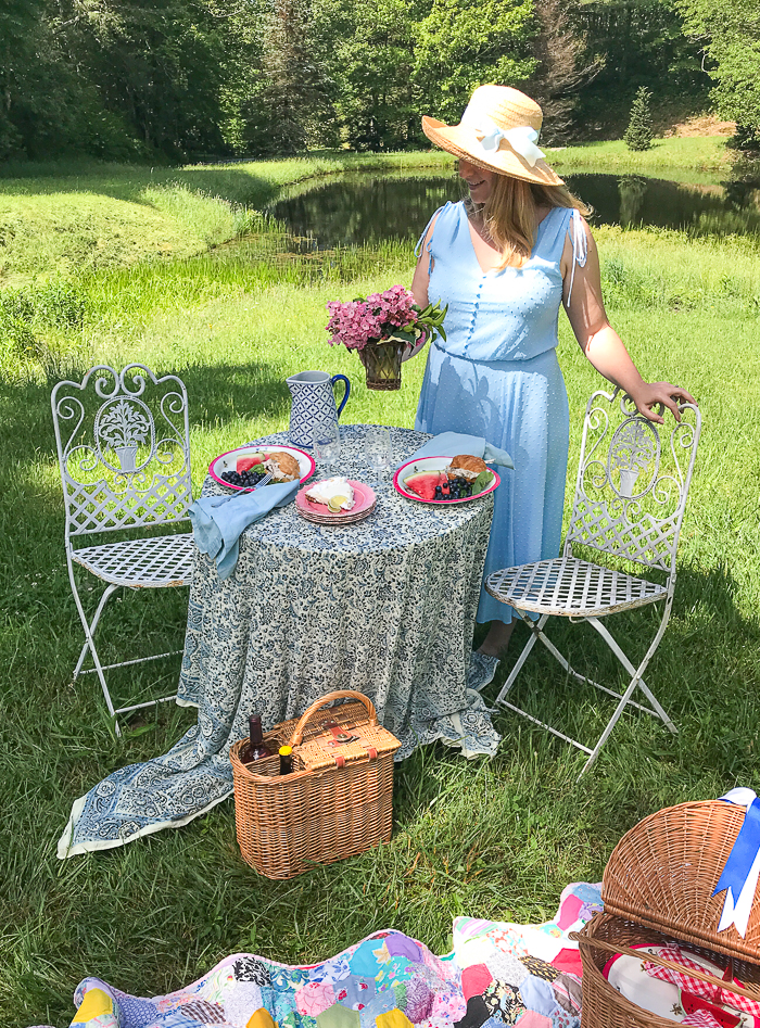 Katherine sets flowers on the picnic table
