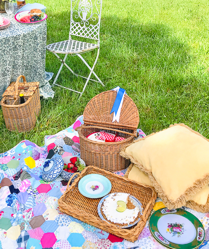 Open picnic basket filled with goodies and key lime pie ready to eat!