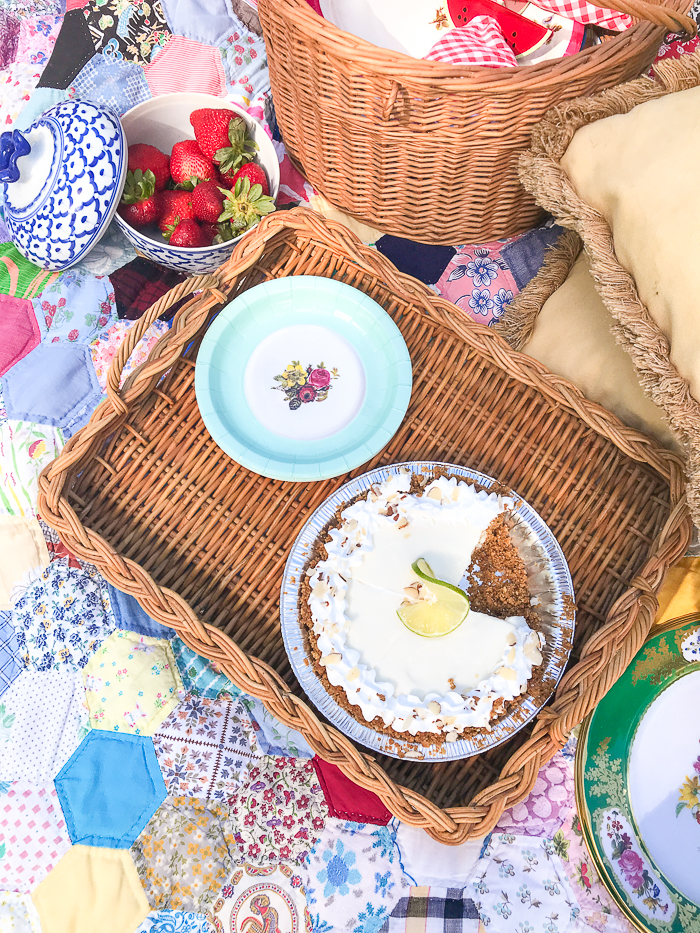 Key lime pie in wicker tray with plates