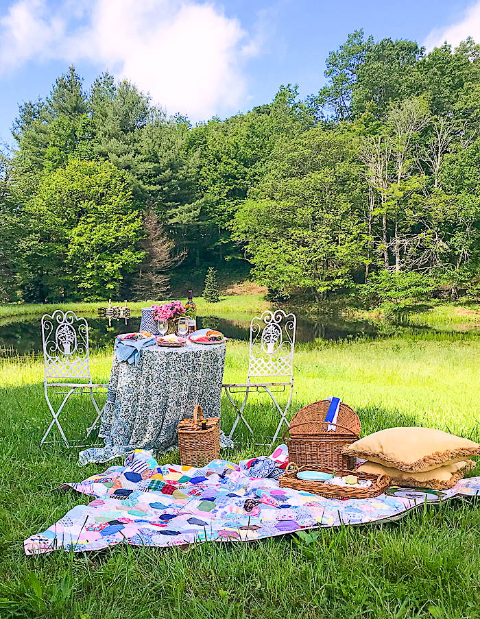 Picnic blanket and table set up for some romantic al fresco dining in the mountains