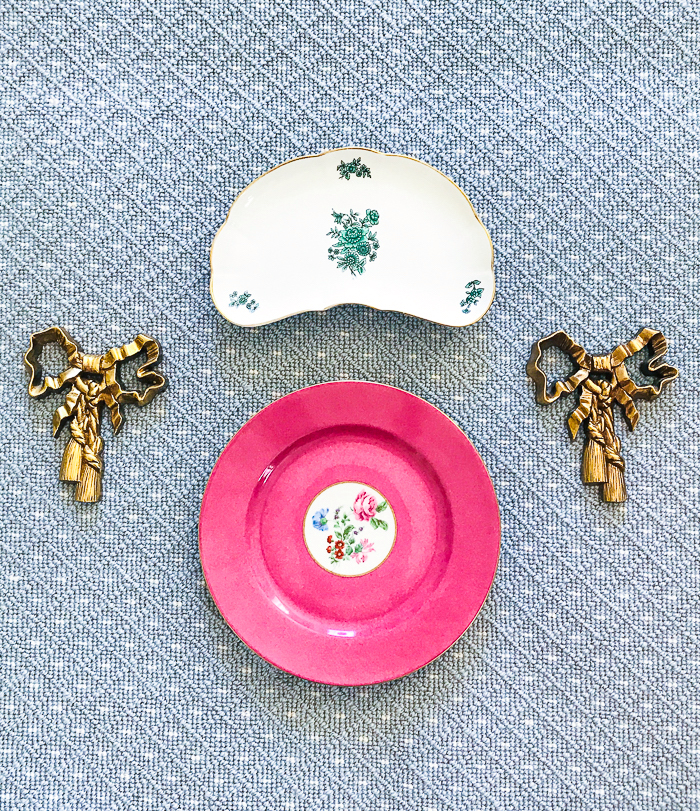 Pink and green antique plates with vintage bow wall moldings