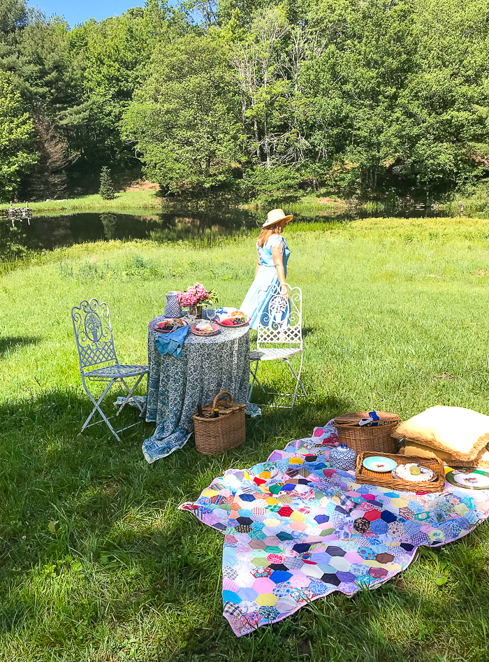 Picnic on the pond with Katherine walking in distance