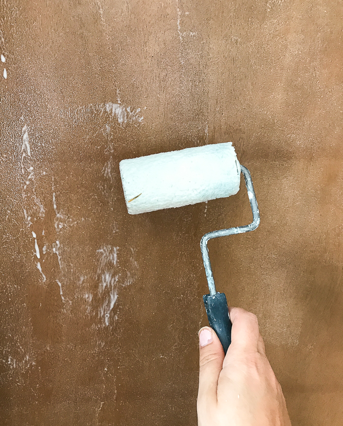 Rolling on glue for wallpaper