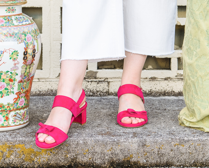 Sassy pink sandal from female designer Sarah Flint with white cutoff jeans