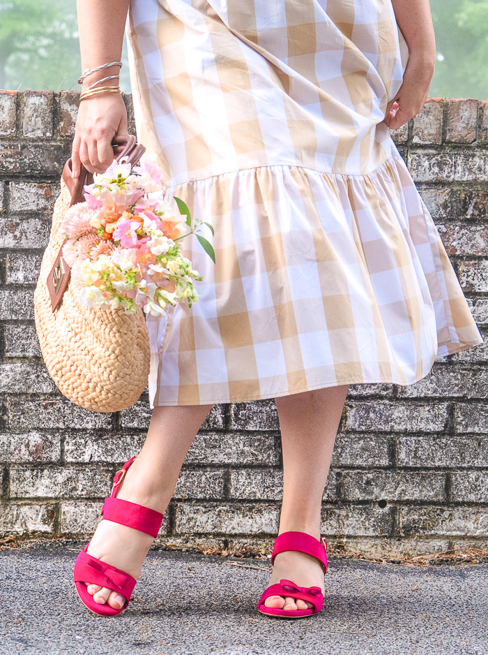 Katherine dancing in gingham dress with pink sandals from Sarah Flint