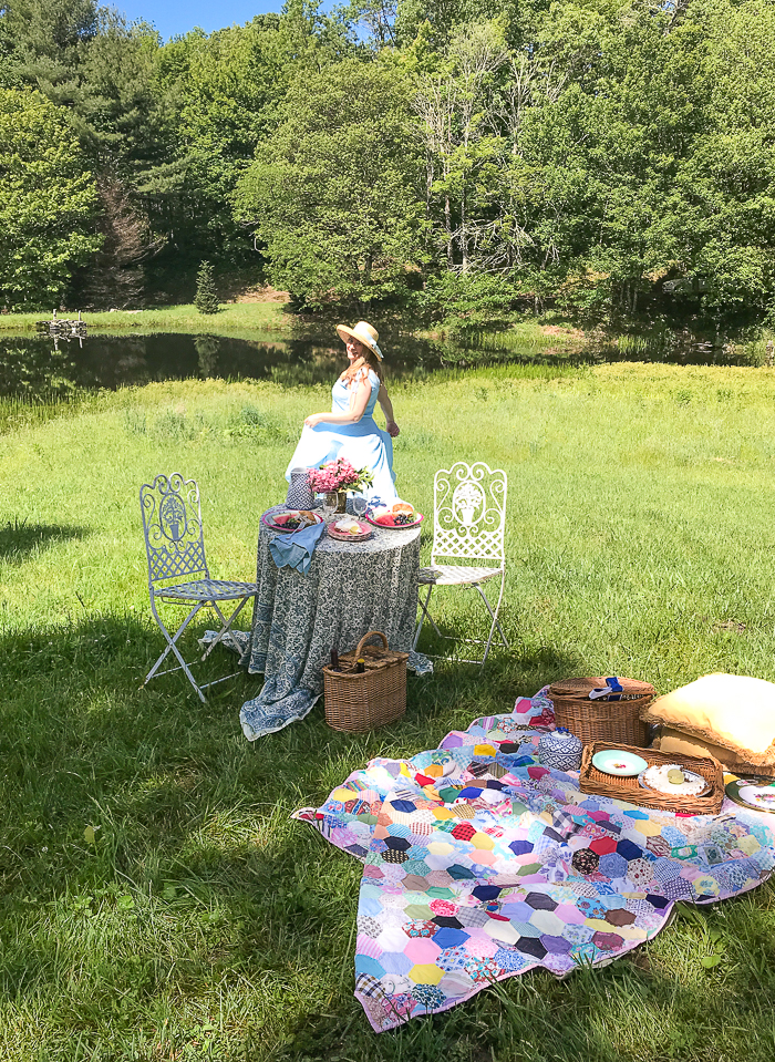 Katherine dancing in sun on a romantic picnic on the pond