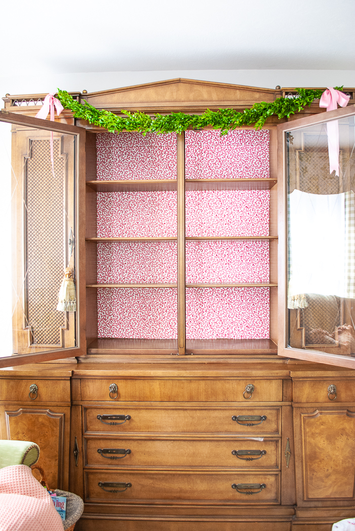 China cabinet with wallpaper backing for an updated charming look