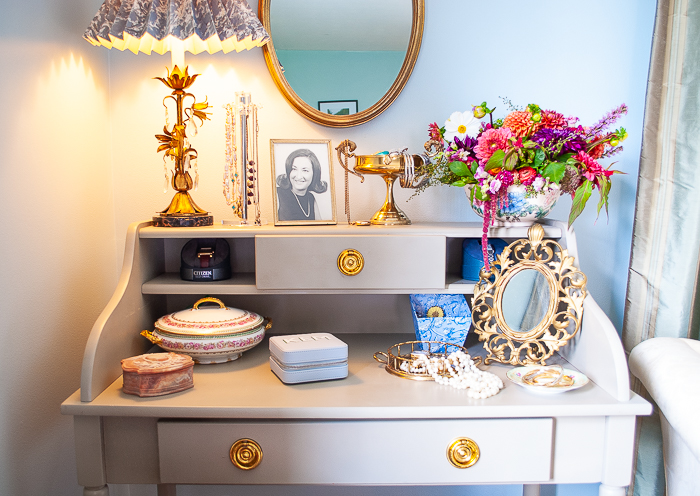 Repurpose a desk for an elegant vintage vanity style to primp and organize jewelry in the bedroom