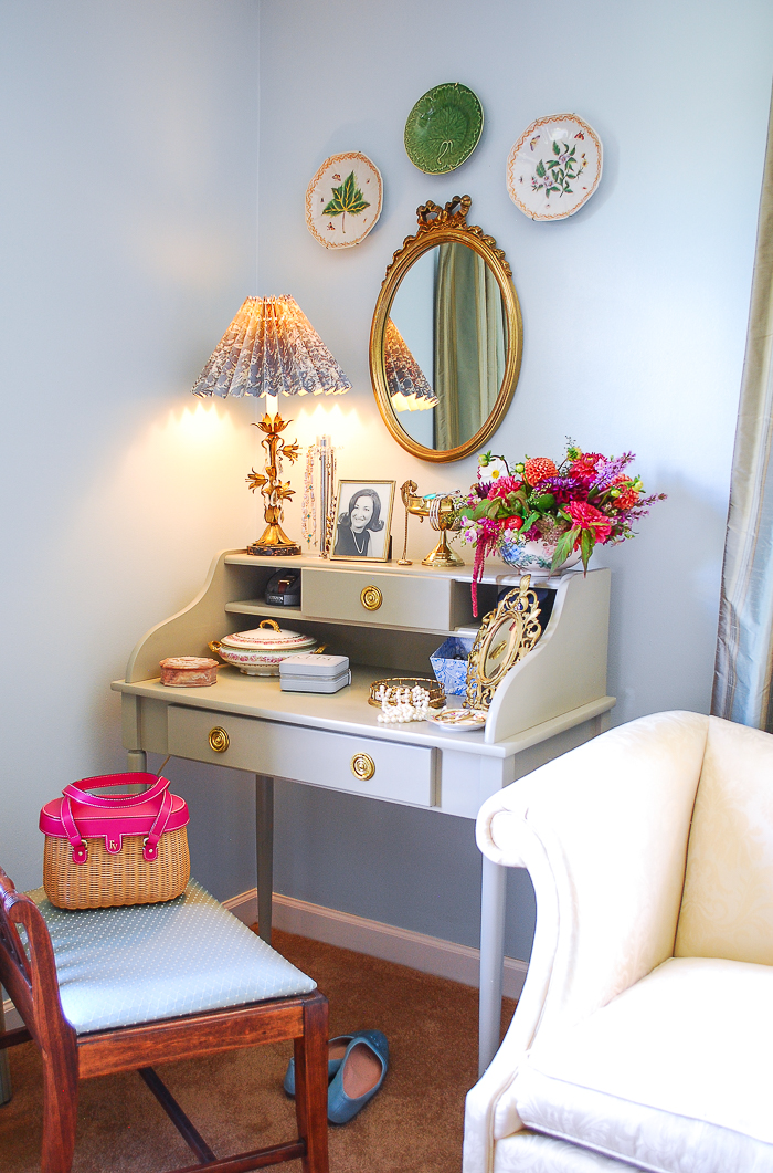 A gray desk with gold hardware and gilt mirror create the basics for this vintage vanity style.