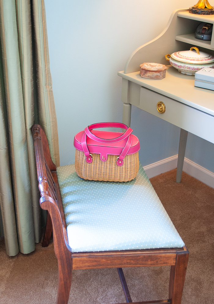 Federal style vintage stool with basket handbag sitting on seat
