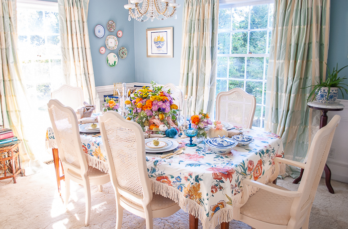 Panoramic view of dining room with table set for autumn