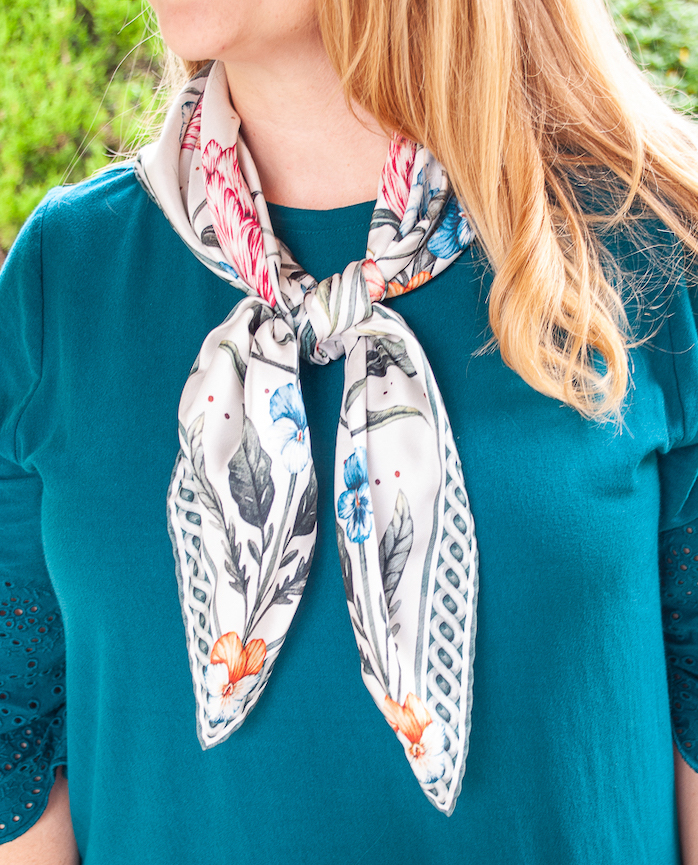 Close up view of the blooming petal scarf tied in a classic girl scout style