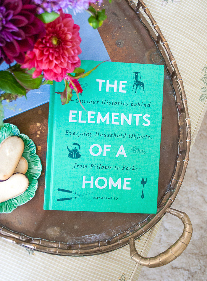 The Elements of a Home by Amy Azzarito book on brass tray