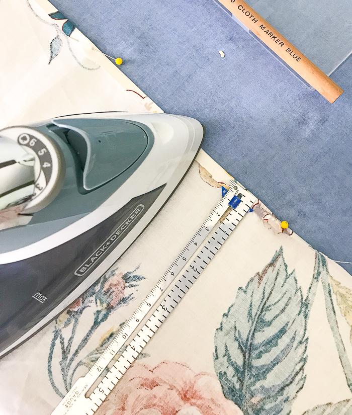 "Use iron and sliding gauge hem ruler to make your first 1/4"" fold for hem"