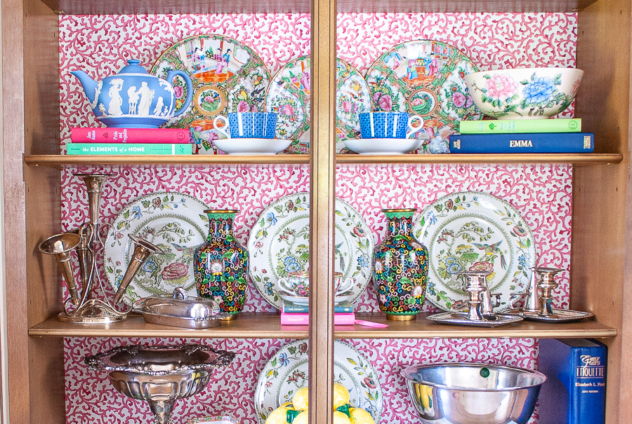 China cabinet styled with rose medallion, ironstone, silver, cloisonné and Wedgwood and lined with vintage Waverly wallpaper in pink Savoy