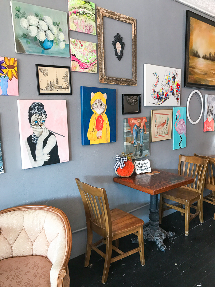 E. Claire's Coffee House gallery wall and table