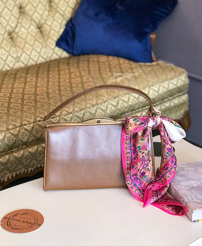 Vintage handbag and scarf on coffee table