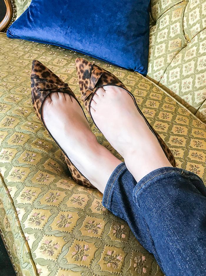 Katherine wearing the Natalie leopard print flats from Sarah Flint on vintage sofa