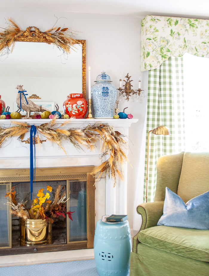 right side view of fall mantel with ginger jars and velvet pumpkins