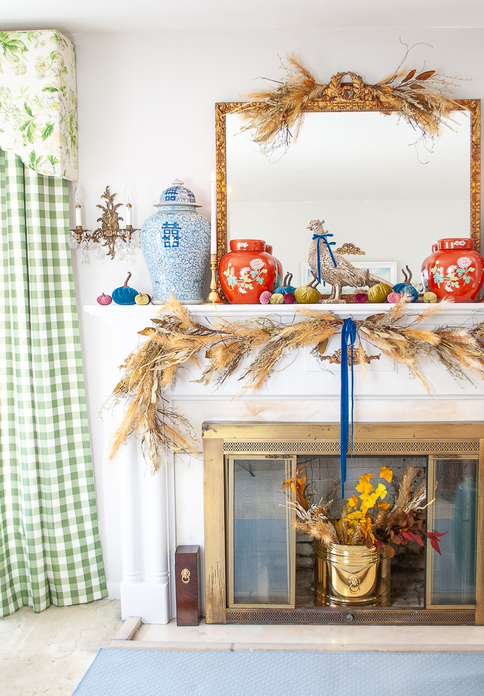 Autumn mantel decor with ginger jars and velvet pumpkins