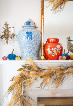 Double happiness temple jar nestled on fall mantel