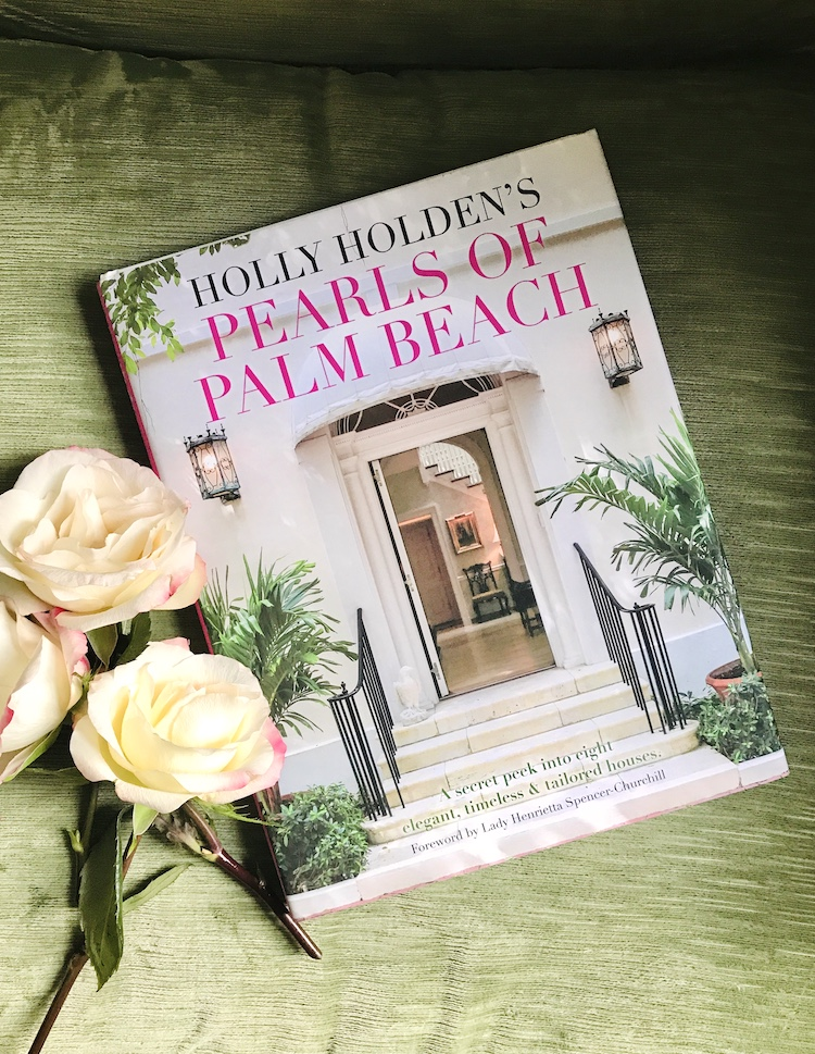 Pearls of Palm Beach by Holly Holden, book rests on green velvet cushion with roses